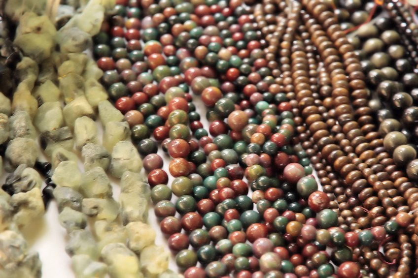 Polished beads on display in vendors booth.