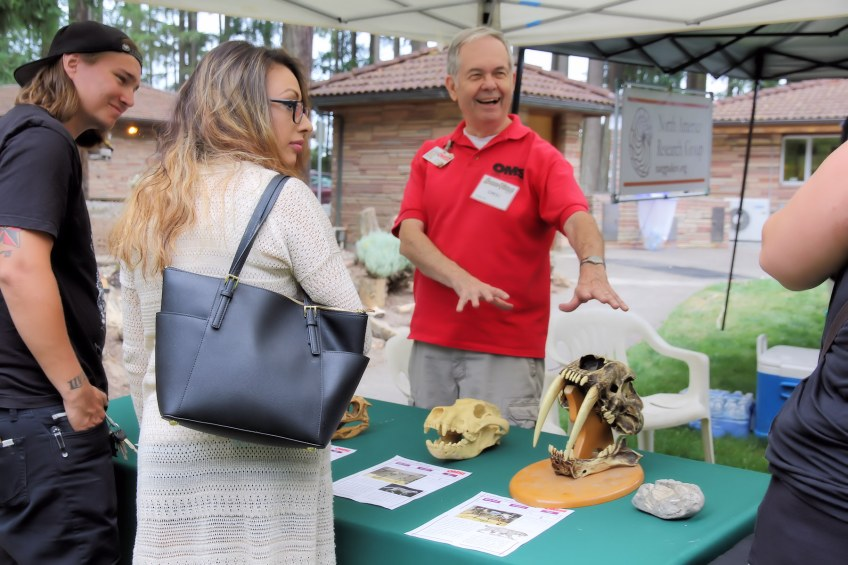 OMSI volunteer offers educational information on fossils.