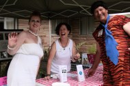 Fred and Wilma Flintstone pose with volunteer Barb Epstein at Silent Auction Booth.