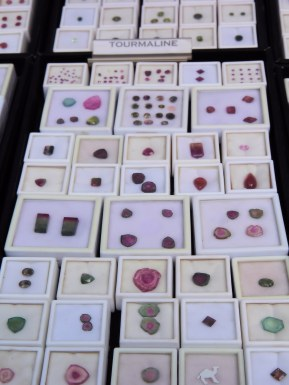 Precious gems on display in vendor's booth.