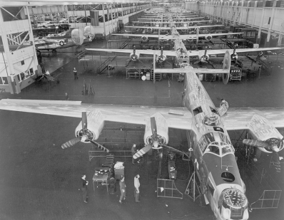 Ford's production techniques go to war: B-24 Liberator bombers come down the assembly line at the enormous Willow Run plant.