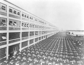 A thousand Model T chassis, here marshaled outside the main Highland Park factory, represented the production of a single nine-hour shift in 1913.
