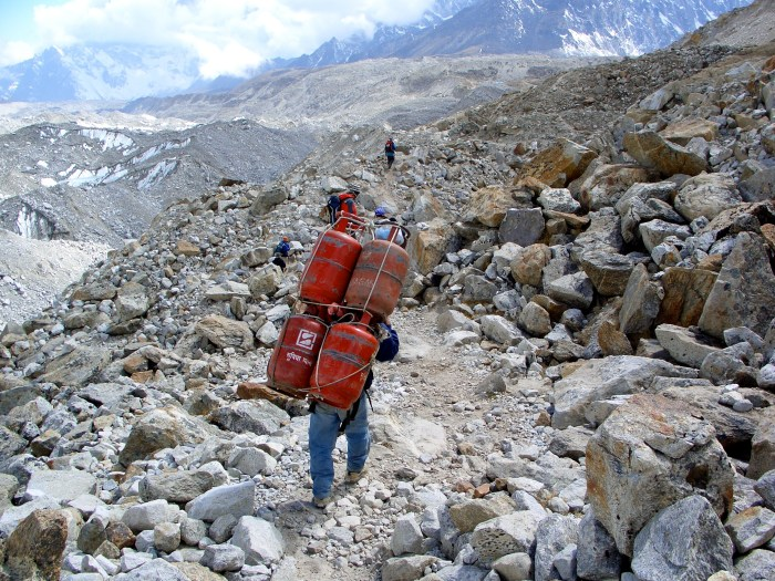 A porter walking out of Everest Base Camp at 5,500 meters