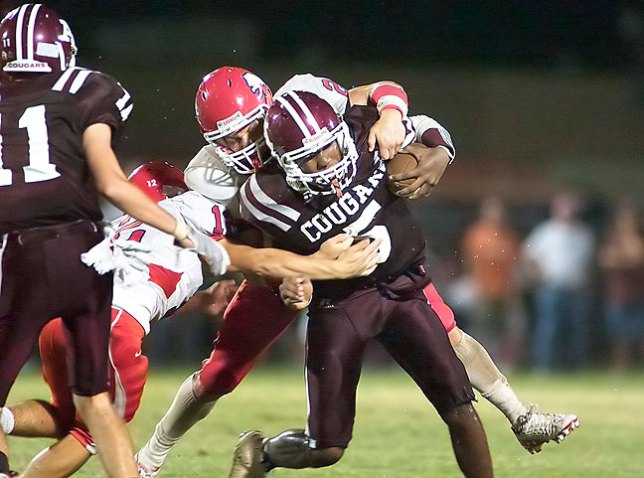 A nice, tight piece of action from last night's football game in Ada. I only broke out the 300mm after I felt certain the threat of rain had passed.