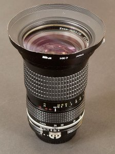 The 25-50mm Nikkor with its excellent slip-on metal lens hood