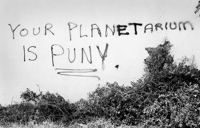 "On one occasion just a week or two later, I observed that the graffiti had been modified to say, ""Your planet is puny,"" followed a week after that with ""Your planetarium is puny."""