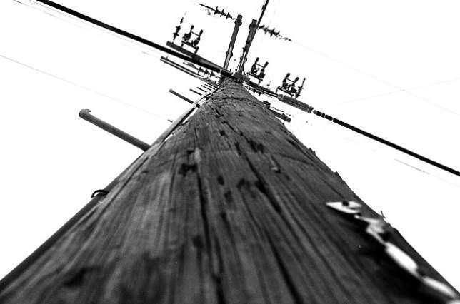 When I shot this in the fall of 1979, I was trying to express a sense of mechanical and technological isolation, using the angled leading lines of the power cables and the symbolism of the cross to capture something bleak and impersonal, all of which echoed my feelings about the world at that time. It probably didn't succeed, but it certainly didn't deserve to be written off in two seconds by some snotty high school newspaper editor.