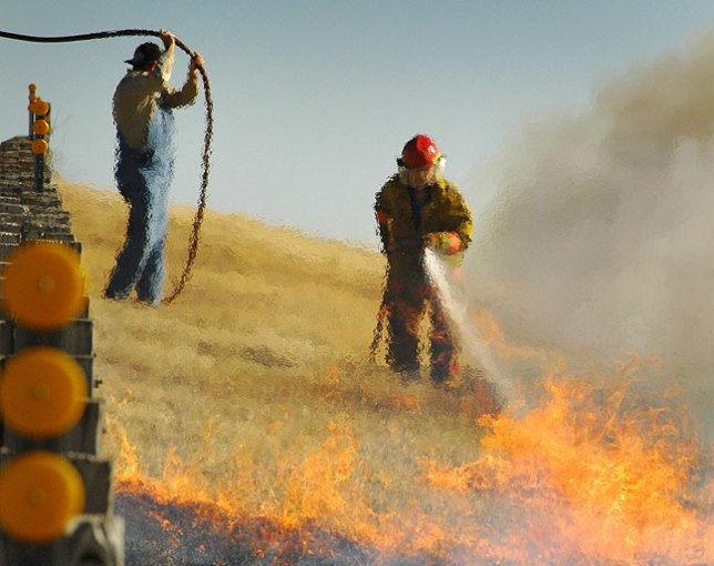 Firefighters attempt to extinguish a wildfire, 2006