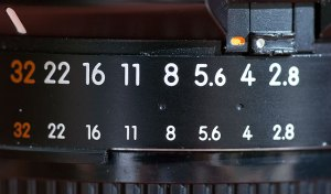 """Another potential lock problem: if the aperture ring on a Nikkor AF lens comes unlocked from its smallest aperture setting, the camera will display """"fEE"""" on the top display and won't shoot. The tab at the upper right is the lock, but I've never gone a month without one coming unlocked."""