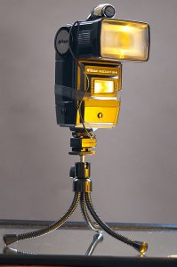 This is my off-camera flash with its slave Velcroed on top, mounted on a bendy-legged tabletop tripod.