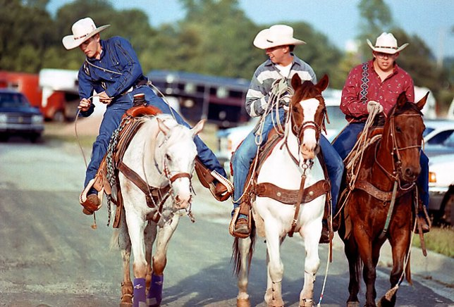 Rodeo cowboys ride into the show arena, June 1996. I found this image while searching my archives for another item, and thought it deserved another moment in the light.