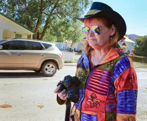My wife Abby and I came across a cattle drive in Mancos, Colorado in October. We both jumped out of the car and tried to chase it down. Abby is pictured here with her Fuji HS30 EXR, a small, light, easy to use and carry bridge/prosumer camera. It would have been close to impossible for her to use a bag full of heavy DSLR gear in a situation like this.