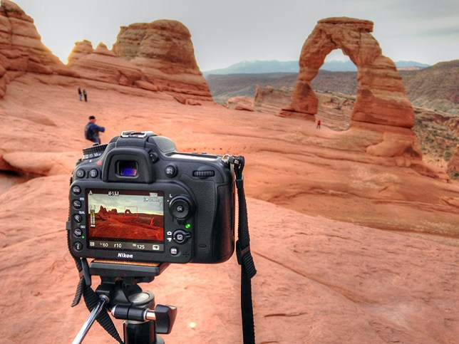 While my Nikon D7100 was making a 10-minute video clip at Delicate Arch in Utah's Arches National Park in October, I made this image of it with my iPhone 5. I later used Photomatix Pro to improve the shadow detail and control the highlights.