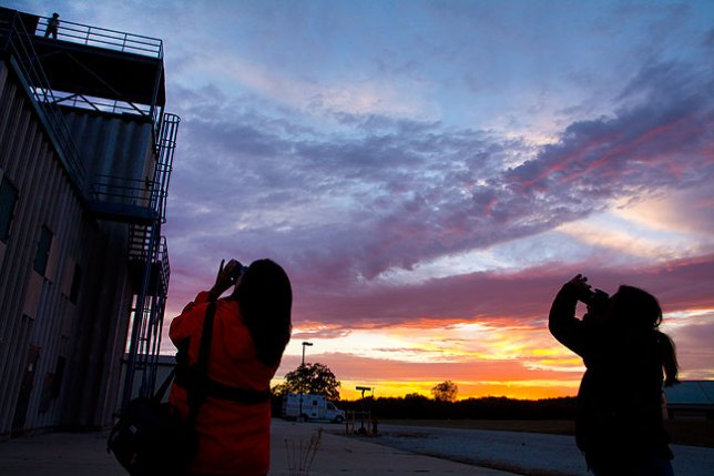 Photography students in last month's advanced class photograph each other at the fire training tower at the Pontotoc Technology Center.