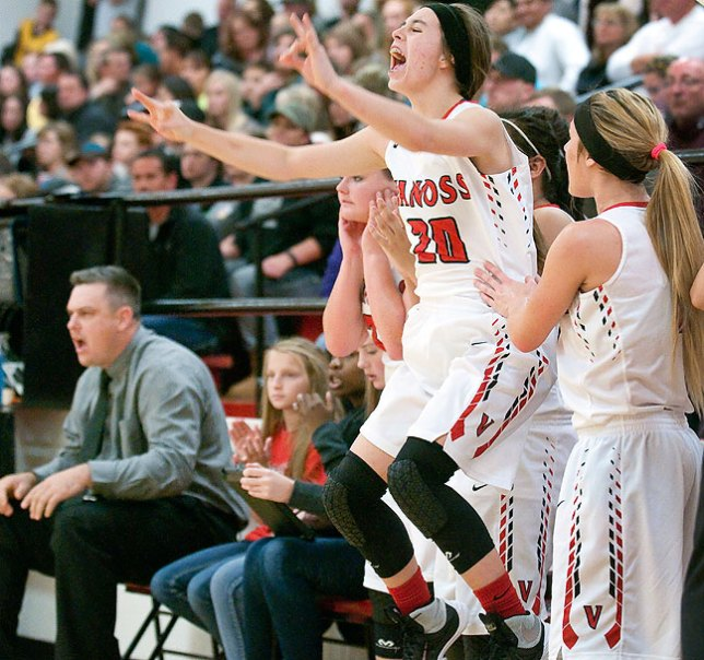 The girls on the Vanoss bench celebrate a fourth-quarter score Saturday night.