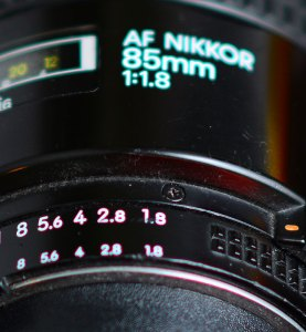 This is classic spherochromatism, as you can see in this image of my old 85mm: the close numbers on the aperture ring have a red cast, and the far letters on the lens barrel are green. This aberration is common to large-aperture lenses.