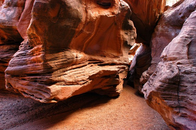 A large boulder forms a passage for the trail through Little Wild Horse Canyon in the San Rafael Swell in central Utah, March 2005.