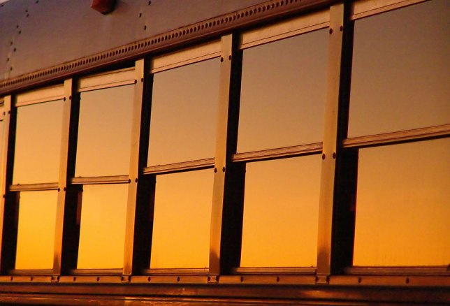 In addition to the sun and sky, objects around us take on very different, and often beautiful, appearances at sunset, like the windows of this bus in Latta, Oklahoma.