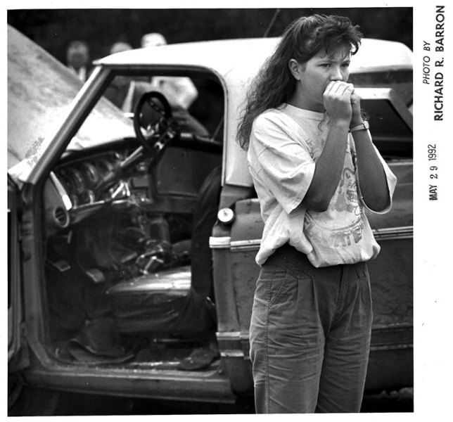 A young women reacts with dismay at the scene of a quadruple-fatality accident involving a funeral procession west of Ada Friday, May 29, 1992.