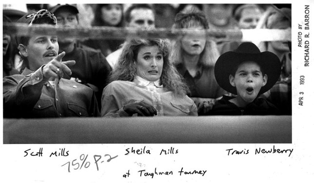 Toughman contest fans react to the action at the Pontotoc Country Fairgrounds in April 1998. Because sticky labels wouldn't adhere to the damp surface of a fresh Ektamatic print, we often just wrote names and places on the prints with felt tip pens or paper-clipped a note with caption information to the print.