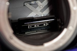 The Nikkormat EL kept it's battery in an unusual spot, in a chamber under the reflex mirror.