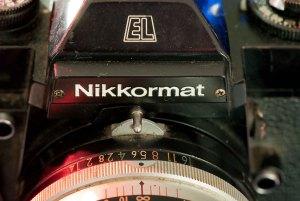 """Mounting a lens on old Nikon cameras required aligning a claw with a post, then rotating the lens to its smallest aperture, then it's largest aperture, to """"index"""" the lens with the camera."""
