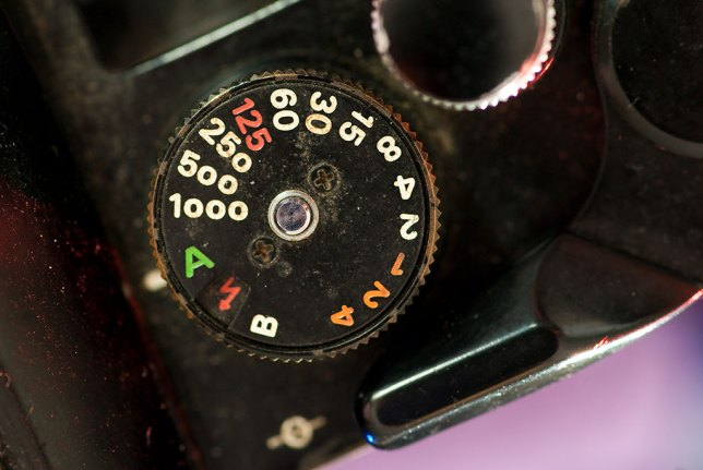 The shutter speed dial on the EL includes aperture-priority automatic. This feature was later quite common in many Nikon cameras, including the FE, which replaced the EL.