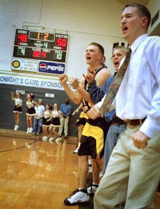 Sometimes sports photography, like sports itself, comes down to a few critical seconds. In this image from a February 2002 area playoff basketball game at Wilburton, Latta Panther players and fans celebrate a go-ahead score against Haworth with just 1.2 seconds remaining in the contest. Latta won the contest to advance to state.