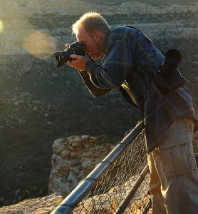 The author switches back and forth between the Nikon D70S, with a wide angle zoom on it (in hand), and the Nikon D100, with a telephoto zoom, at Mesa Verde National Park in October 2005.