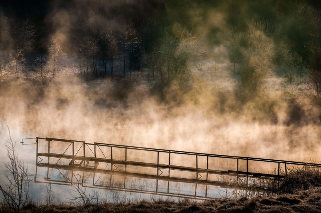 Steam billows over a farm pond between Byng and Ada, Oklahoma Saturday morning, March 16; shot with the Nikon D300S and the AF-S Nikkor 80-200mm f/2.8.