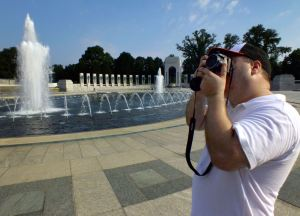 Our son-in-law Tom Reeves uses his FinePix S4500 to photograph the World War II National Memorial in Washington DC in 2013.