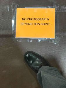 I saw this sign taped to the floor at a graduation I was covering recently, and I ignored it.