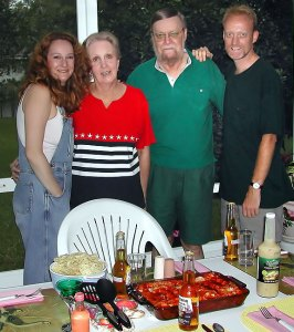 The Barron family, Florida, summer 2003, eating on the lanai; this was the first time my father had ever eaten guacamole, and he liked it; Abby made vegan enchiladas (Photo by Abby S. M. Barron)