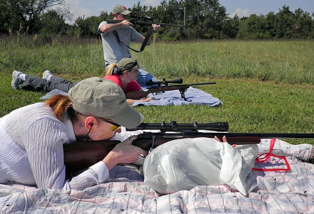 Abby shoots from the prone position with her father's .22-250 bench rest rifle, Michelle shoots Matthew's .17 caliber, and Matthew zeroes in with his scoped .22lr at our pond yesterday.
