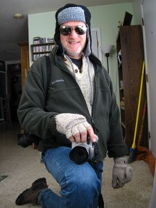 Ready to go outside in the 12º weather: insufferably warm ragg wool sweater, Columbia fleece, ski hat, photographer's mittens, and my darkest sunglasses.