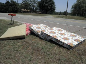 Our old mattresses piled by the side of the road early this afternoon look like a deck of very fat playing cards.