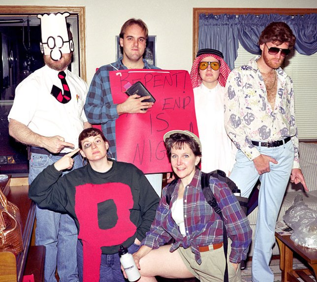 This is the Norman gang and me in 1997. In the front row are Anna as a black-eyed pea and Anne as a hiker. In the back row are Michael as Dilbert, David as an evangelist, Thea as an Arab Sheik, and me as Joe Barron in 1976.