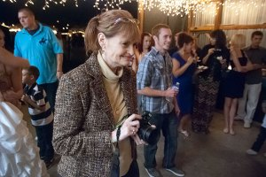 Abby smiles while photographing last night's wedding reception at her aunt Judy's farm in Duncan, Oklahoma.