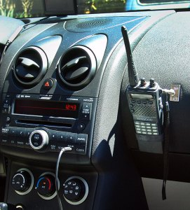 With the handheld radio (in this case my Kenwood TH-22AT) handing on the dash, it's easier to hear and operate, and its antenna is in the open for better reception. I'm sure such a mount point could be used for any number of devices.