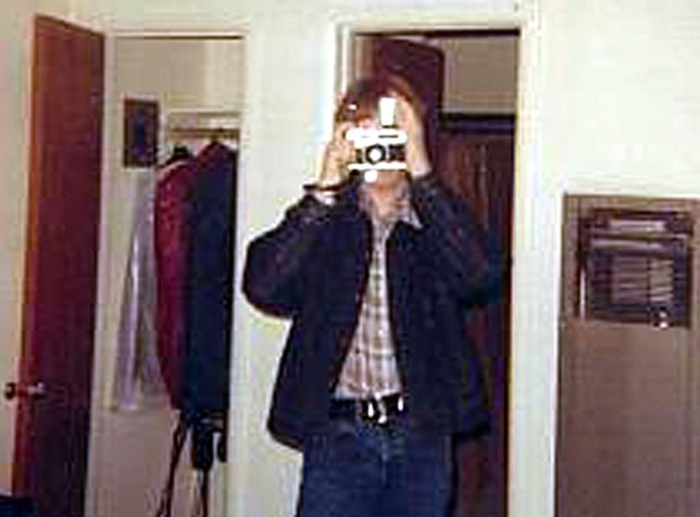 Denim jacket, plaid shirt, and camera; the essence of me in high school.