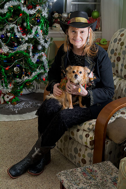 Abby has been cultivating a new look this fall, and felt it all came together just right Tuesday night, so she asked me to make this image of her with Sierra the Chihuahua in front of our Christmas tree.