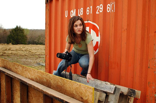 Ashley Holloway climbs on a pallet at the vo-tech during my advanced photography class in March 2009. Her movements in this image look a bit like she is trying to escape the apocalypse.