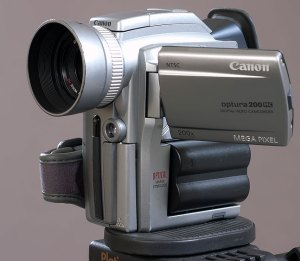 This is the Canon Optura 200 DV camcorder of 2003 vintage. In addition to making only mediocre video, the microphones on this camera are poorly positioned, and pick up a lot of operating noise from its internal mechanism.