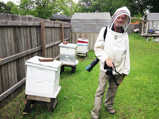Your host smiles while photographing an apiary this morning.