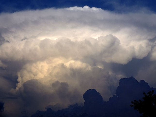 Cumulonimbus clouds billow east of our home recently. We could expect more rain today and tonight.