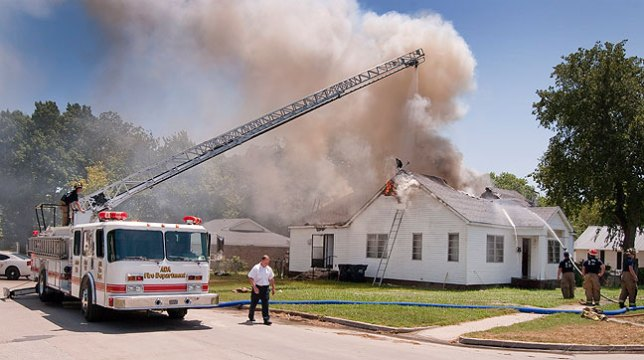 It is a rare house fire that requires the ladder truck, but this one, in 100-degree heat, was a tough job.