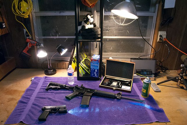Gun cleaning how-to videos always say to clean your weapons in a clean, dry, well-ventilated, well-lit space, and this bench in the garage, now free of junk, is all that.