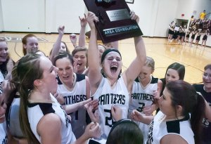 The Latta Lady Panthers hold up their Class 2A Area Consolation Championship trophy Saturday. The victory earned them a place in the state tournament this week.
