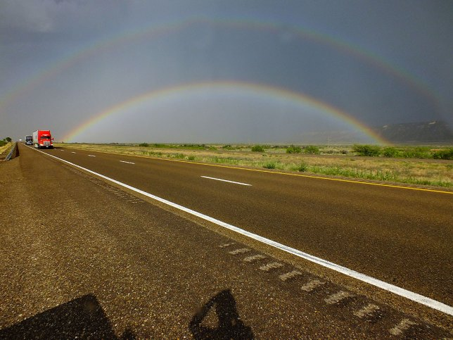 Despite rain still falling on us, I got out of the truck to photograph this amazing double rainbow on Interstate 40 in eastern New Mexico. It was just the start of a great week on the road.