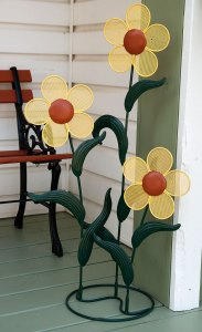 Abby and I repainted this metal flower decoration by her design, and we both think it looks very cheerful.